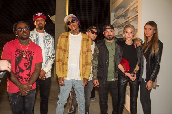 Wiz Khalifa, center, hit up a party to celebrate an installation at Alchemist at 1111 Lincoln Road.