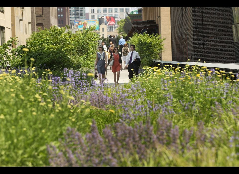 NEW YORK, NY - JUNE 07: People walk along a path on the newly-opened second section of the High Line park in on June 7, 2011