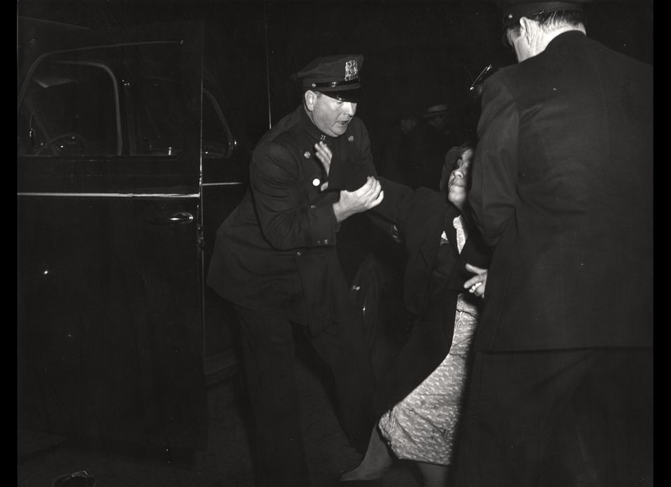 Weegee, The dead man's wife arrived...and then she collapsed, ca. 1940. © Weegee/International Center of Photography.