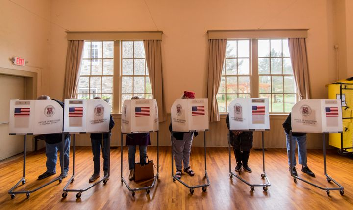 Voters fill out their ballots at the Old Stone School polling location in Hillsboro, Virginia, on Nov. 6.