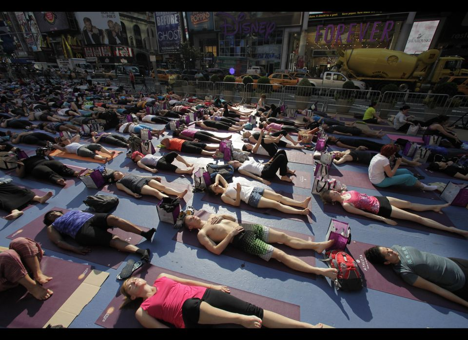 Thousands of yoga enthusiasts convene in New York's Times Square to mark the summer solstice, Wednesday, June 20, 2012. Tempe