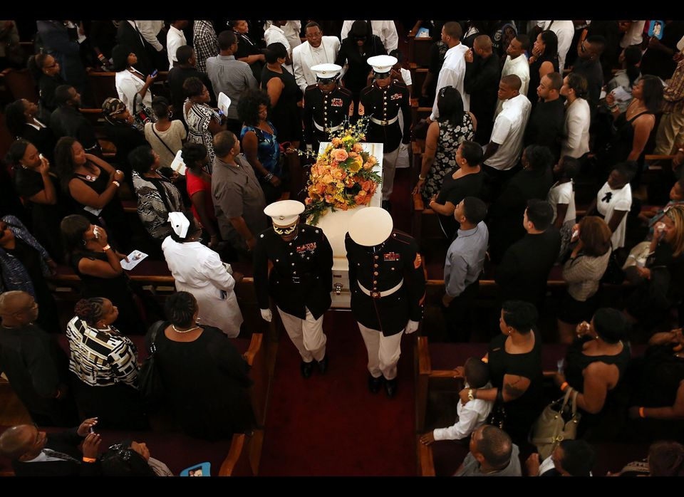 Harlem Youth Marines carry out the coffin at the conclusion of the funeral for 4-year-old Lloyd Morgan, who was killed by a s