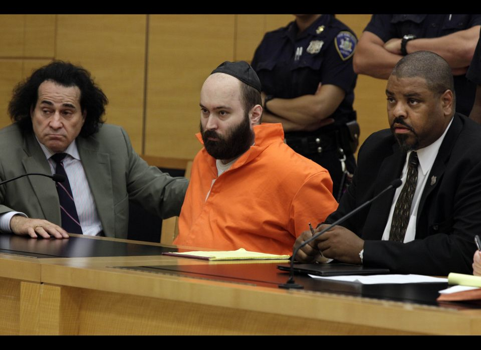 Levi Aron, center, listens to a plea hearing with his attorneys Howard Greenberg, left, and Pierre Bazile, in Brooklyn Suprem