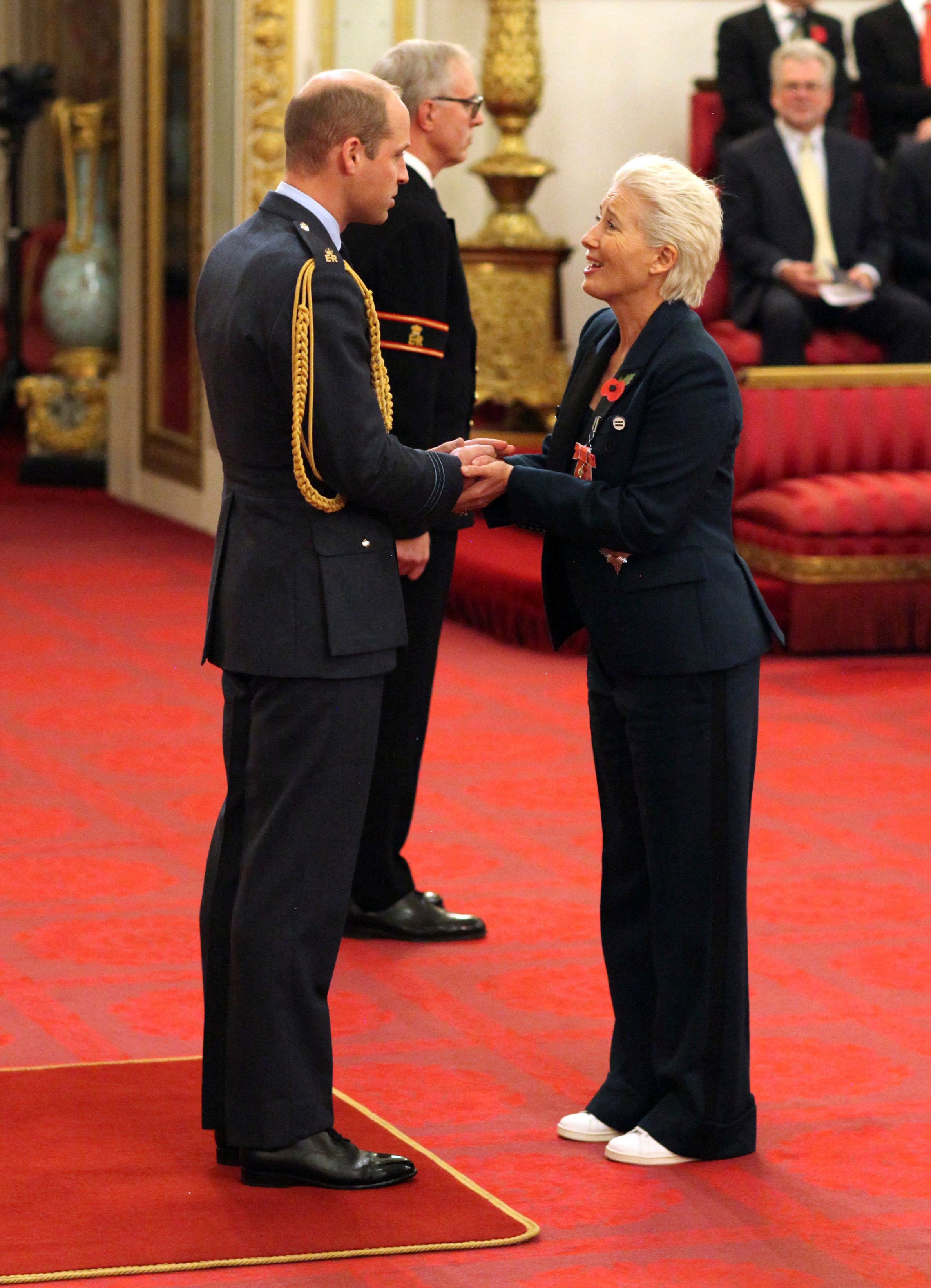 Emma Thompson receives Britain's highest honor at Buckingham Palace on Wednesday.