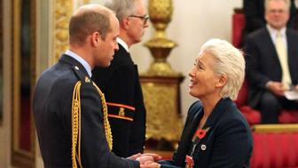 Emma Thompson is made a Dame Commander of the British Empire by Prince William at Buckingham Palace, London, Wednesday Nov. 7, 2018. (Jonathan Brady/PA via AP)