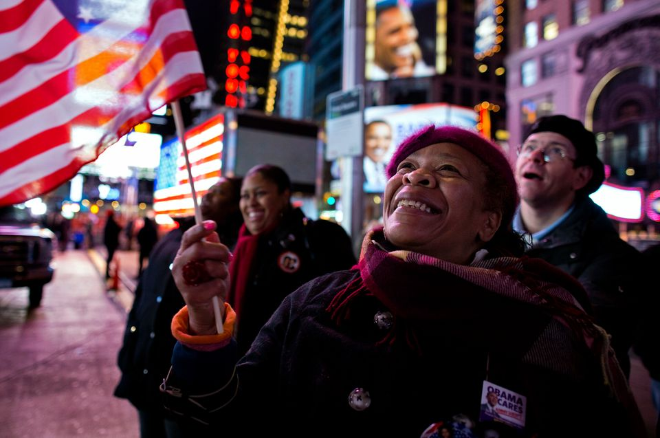 Ana Sledge of New York celebrates in New York's Times Square, Wednesday, Nov. 7, 2012, after President Barack Obama was proje