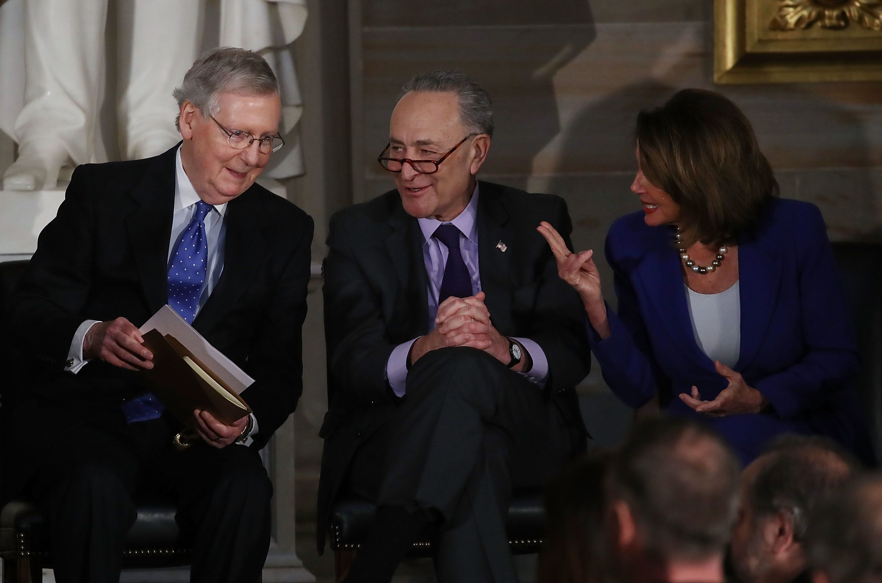 WASHINGTON, DC - JANUARY 17:  (L-R), Senate Majority Leader Mitch McConnell (R-KY), Senate Minority Leader Charles Schumer (D-NY) and House Minority Leader Nancy Pelosi (D-CA), confer during a ceremony awarding former Senate Majority Leader Bob Dole the Congressional Gold Medal at the U.S. Capitol on January 17, 2017 in Washington, DC.  (Photo by Mark Wilson/Getty Images)
