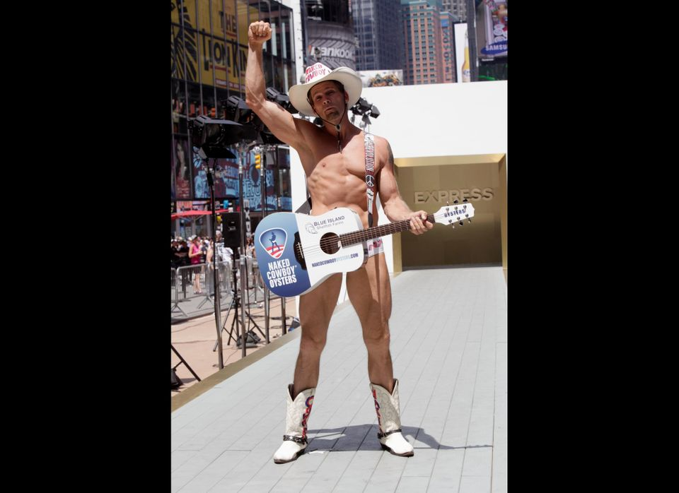 The Naked Cowboy walks the runway as Express breaks Guinness World Record for most people to walk in a runway show in Times S