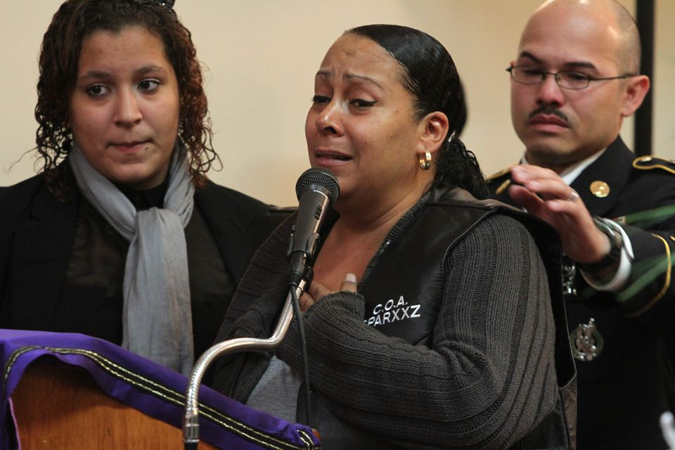 Cecilia Reyes, center, speaks during the funeral service for her son Noel Polanco as her daughter and Polanco's sister Amanda