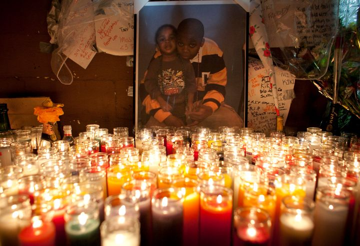 NEW YORK, NY - MARCH 13: A photograph of Kimani Gray and his younger sister is illuminated by candles at a memorial in his ho
