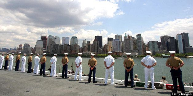 UNITED STATES - MAY 22:  Sailors and Marines aboard the USS Kearsarge stand at attention on the rails as they enter New York