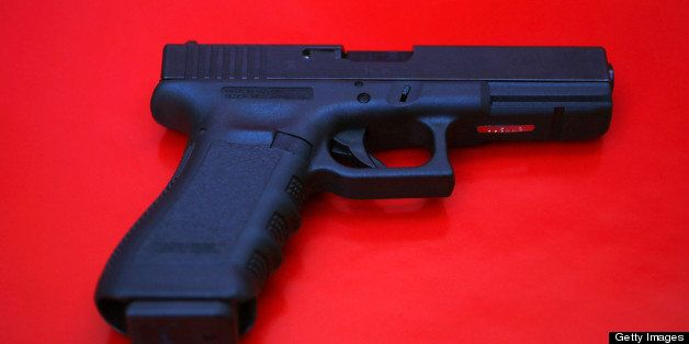 MIAMI, FL - DECEMBER 18:  In this photo illustration a Glock pistol is seen on December 18, 2012 in Miami, Florida. The weapo