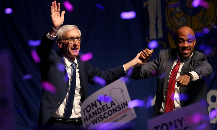 Evers, left, defeated Walker in the race for governor.