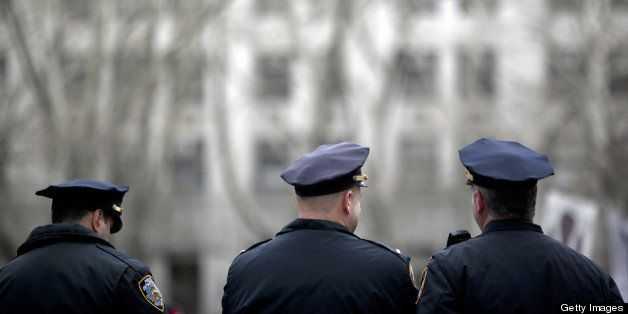 NEW YORK, NY - MARCH 18:  New York CIty Police officers stand near a demonstration against the city's 'stop and frisk' search