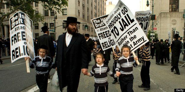 A man and a few boys walk toward a protest of the Alliance of American Jews in protest against the Israeli Draft June 9, 2013
