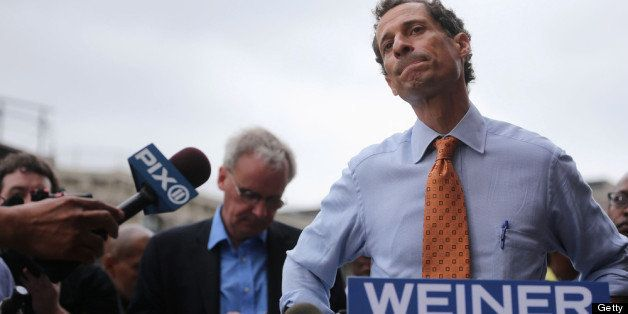 NEW YORK, NY - MAY 23:  Anthony Weiner listens to a question from the media after courting voters outside a Harlem subway sta