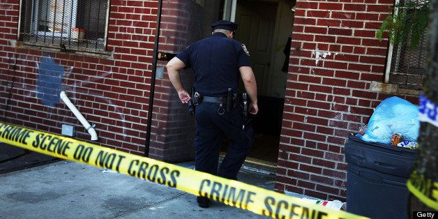 NEW YORK, NY - JUNE 04:  Police stand near the scene of a murder on June 4, 2013 in the Brooklyn borough of New York City. Wh