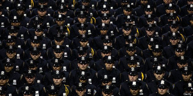 NEW YORK, NY - JULY 02:  New York City Police Academy cadets attend their graduation ceremony at the Barclays Center on July