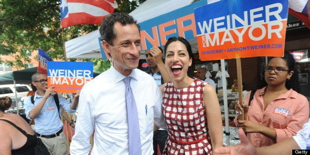 Mayorial candidate Anthony Weiner and his wife Huma Abedin campaigning on W. 111 St. (Photo by Andrew Savulich/NY Daily News