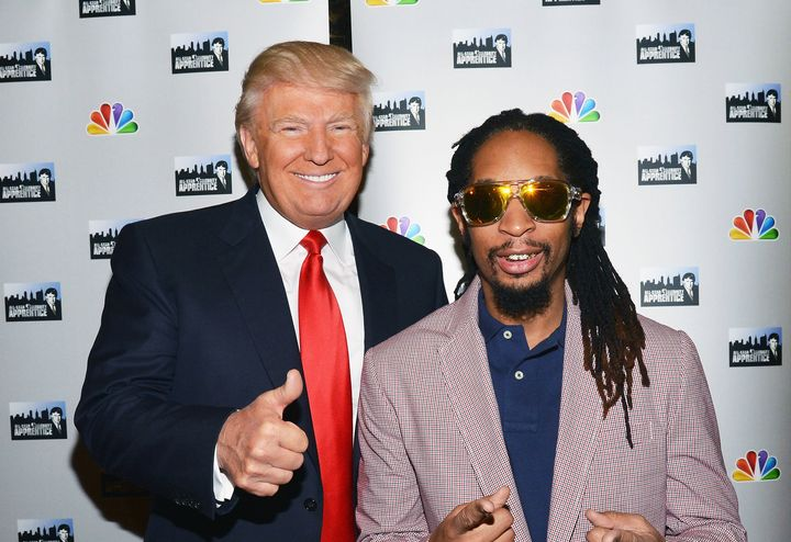 Donald Trump and Lil Jon attend a red carpet event at Trump Tower on May 16, 2013, in New York City.
