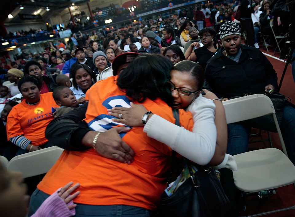 NEW YORK - APRIL 23:  Rodney Garcia his wife Shanee Garcia hug a teacher (Lt) as they hear their four-year-old daughter was a
