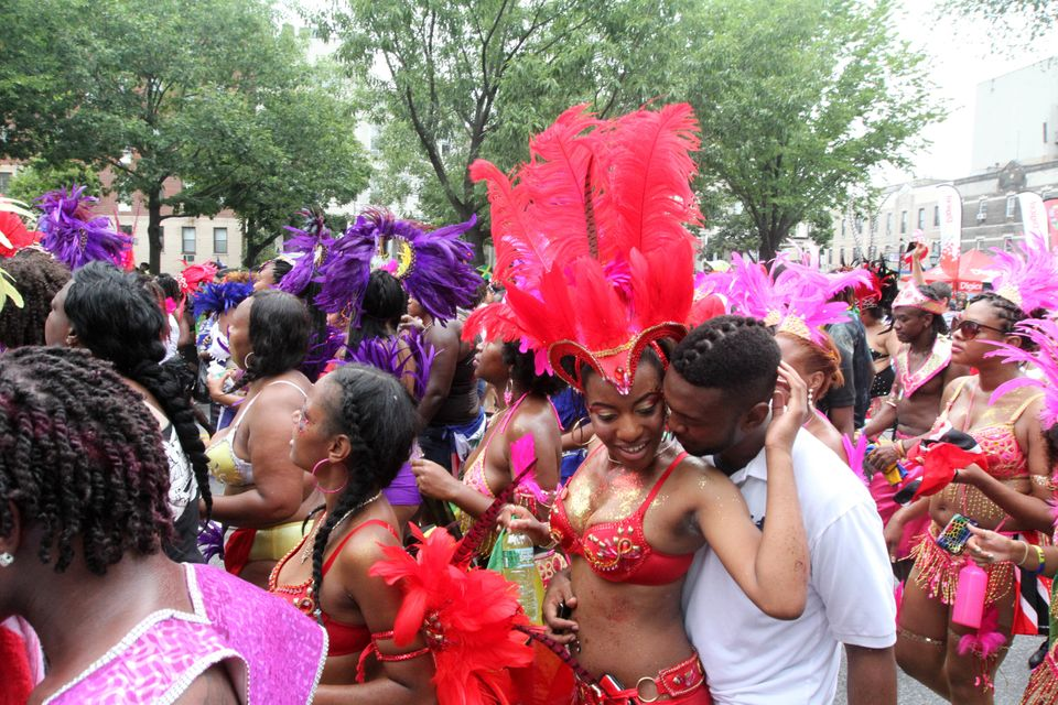 Parade participants make their way along Eastern Parkway in the Brooklyn borough of New York during the West Indian Day Parad
