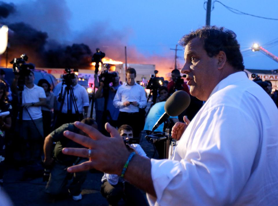 New Jersey Gov. Chris Christie addresses the media near the area hit by a massive fire on Thursday, Sept. 12, 2013, in Seasid
