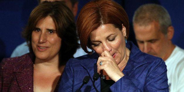 NEW YORK, NY - SEPTEMBER 10: New York City Council Speaker Christine Quinn speaks next to her wife Kim Catullo (L) during her