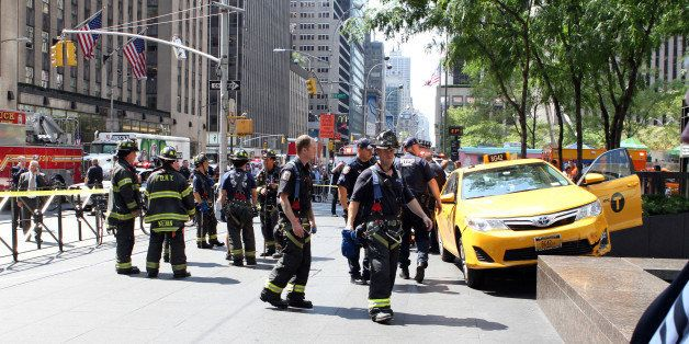 Firefighters, Dr. Oz and bystanders rushed to tourist Sian Green struck by out-of-control taxi cab on Sixth Ave. and W. 49th