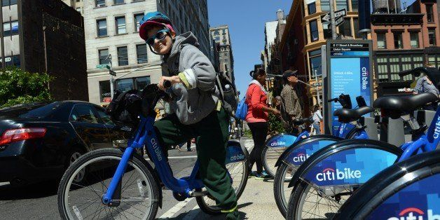 With AFP Story by Brigitte DUSSEAU: US-Transport-Bicycle-Share-CitiBike Laura Glenn-Hershey rides a Citi Bike bicycle from a