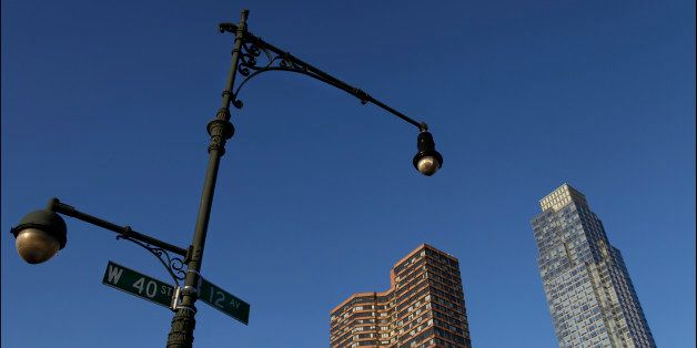 View of a street lamp and sign at 12 Avenue (aka the West Side or Lincoln Highway) and West 40th, Midtown Manhattan, New York