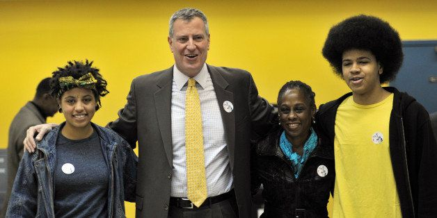 New York City Democratic mayoral candidate Bill de Blasio (2nd L) with his wife Chirlane McCray (2nd R), daughter Chiara (L)