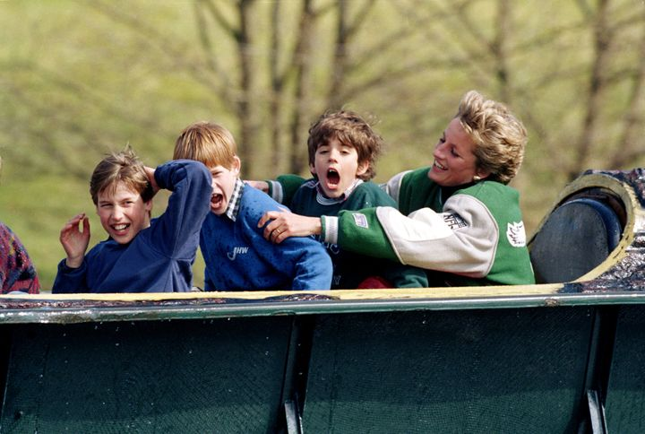 Princess Diana with Prince William (left), Prince Harry and a friend at an amusement park in 1994.