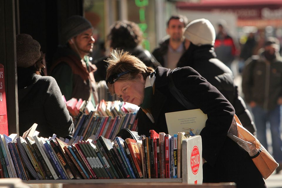 NEW YORK - A woman shops for books at The Strand bookstore along Broadway on March 1, 2010 in New York City.
