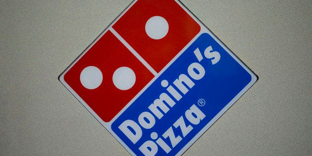 A Domino's Pizza logo hangs inside a franchise on 89th Street in New York, U.S., on Wednesday, Jan. 13, 2010. Domino's Pizza
