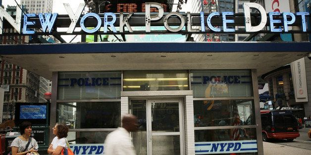 NEW YORK, NY - AUGUST 12:  People walk by a New York Police Department (NYPD) outpost in Times Square on August 12, 2013 in N