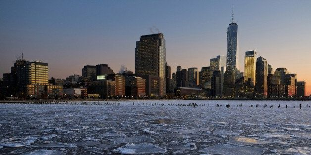 NEW YORK, NY - JANUARY 09:  Ice floes fill the Hudson River as the Lower Manhattan skyline is seen during sunset on January 9