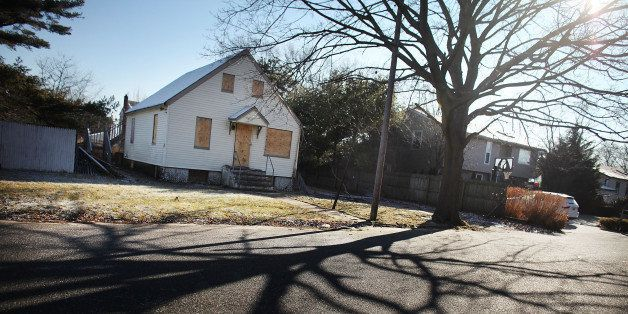 ISLIP, NY - FEBRUARY 09:  A foreclosed home stands boarded up on February 9, 2012 in Islip, New York. A New York State Depart