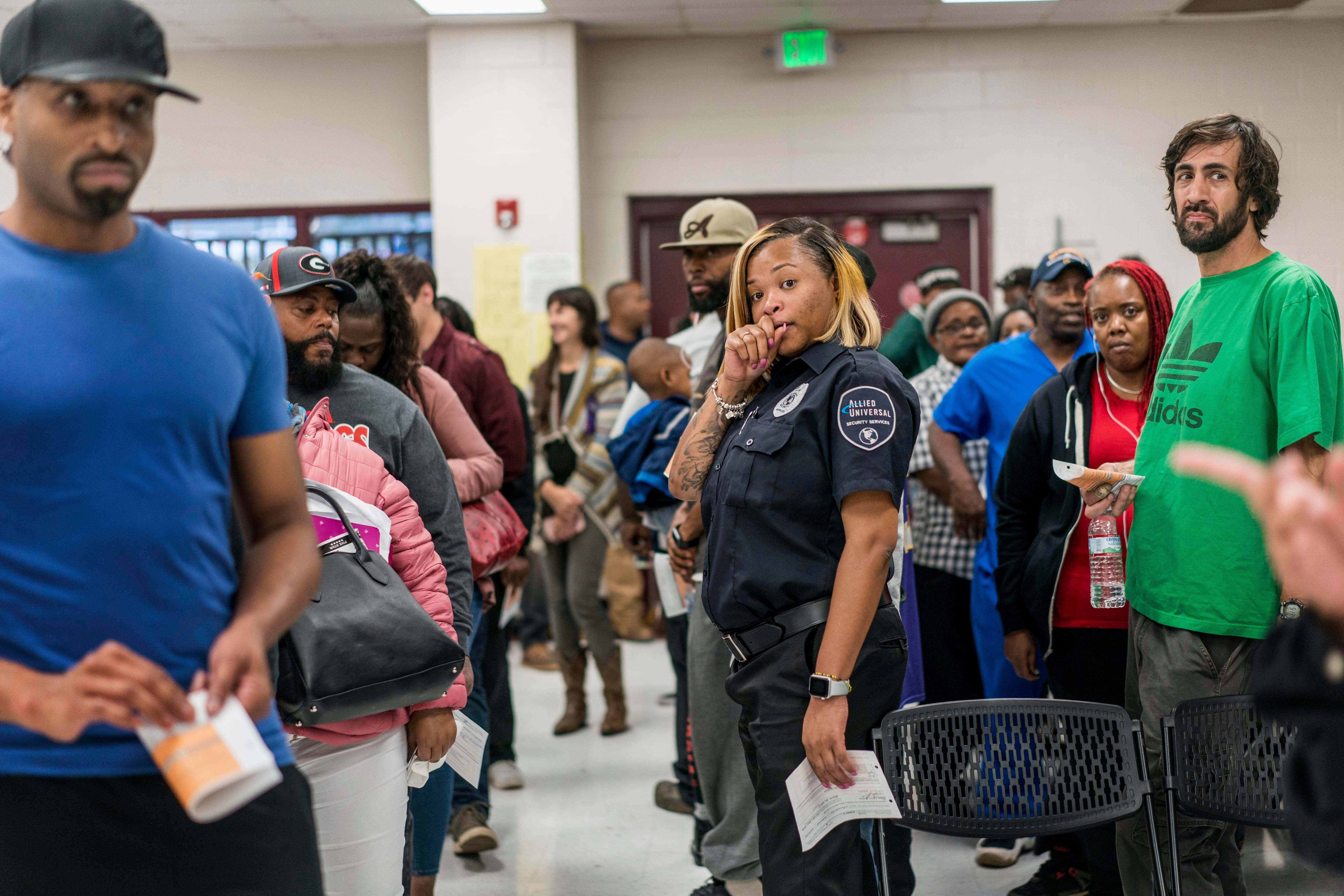 People stand in line to vote at the Pittman Park Recreation Center polling location in Atlanta. A limited number of voting ma