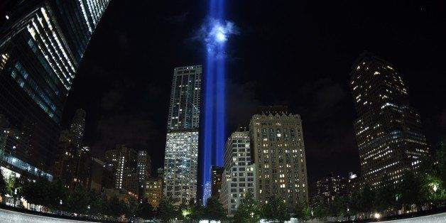 The Tribute in Light illuminates the sky  behind the  9/11 Memorial waterfalls and reflecting pool in New York on September 1