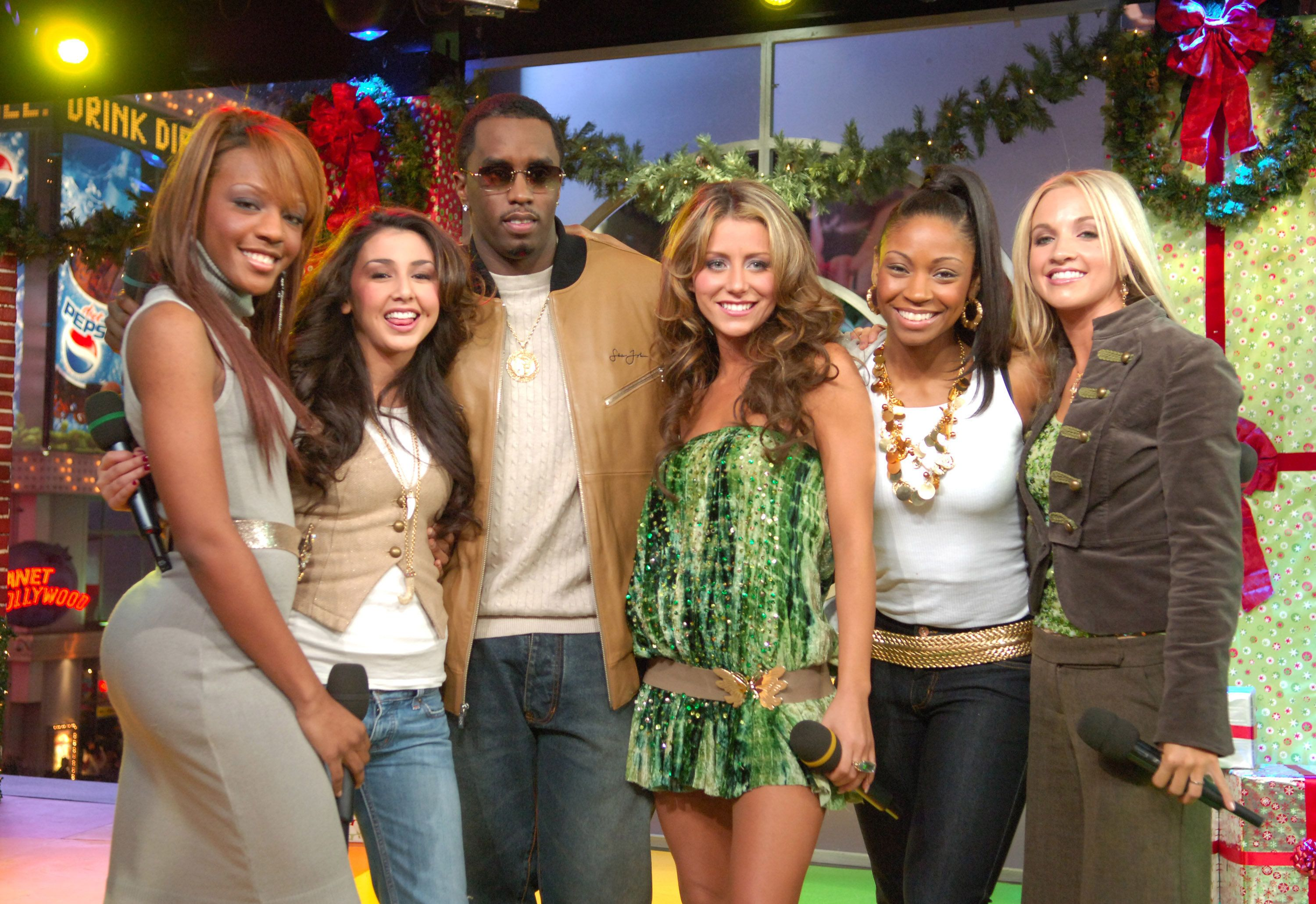 "(From left) Dawn Richard, Aundrea Fimbres, Sean Combs, Aubrey O'Day, D. Woods and Shannon Bex on ""TRL"" in 2005."