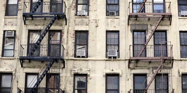 NEW YORK CITY, UNITED STATES - SEPTEMBER 24: Decayed facade of an apartment building in Manhattan on September 24, 2014, in N