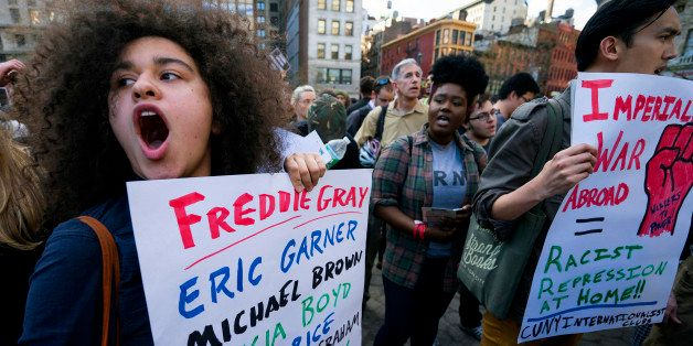Protesters yell out in Union Square Wednesday, April 29, 2015, in New York. People gathered to protest the death of Freddie G