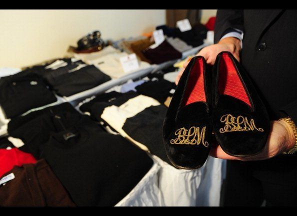 A pair of slippers belonging to Bernie Madoff, embroidered with his BLM initials in gold, are displayed during a press previe