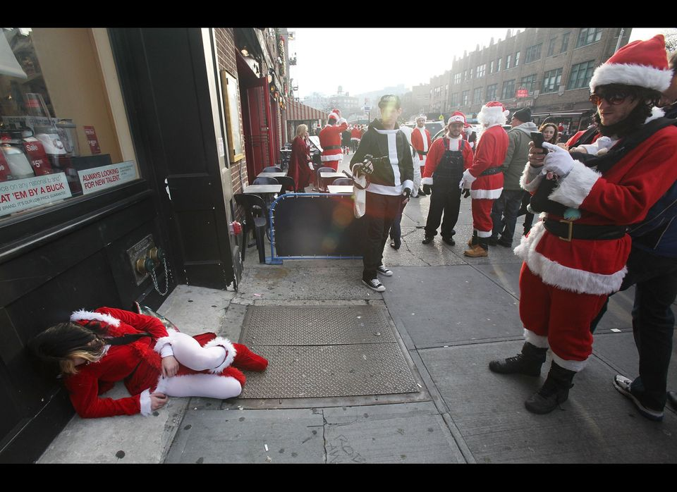 NEW YORK, NY - DECEMBER 11:  A reveler dressed as Santa Claus takes a nap during the annual Santacon event December 11, 2010