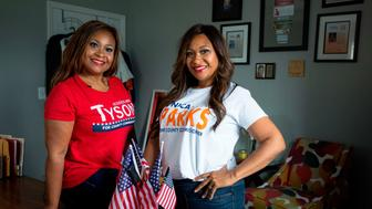 Jessica Ann Tyson (L) and Monica Sparks, twin sisters pose on July 21, 2018 in Kentwood, Michigan. - Sparks and Tyson are twin sisters from Kentwood, Michigan. Both sisters are running for political office in their individual communities. Monica is a Democrat running for County Commissioner in District 12. Jessica is a Republican seeking the County Commissioner position in District 13. While the two hold very different views on the current administration, they have maintained their close bond. (Photo by Steven M. Herppich / AFP)        (Photo credit should read STEVEN M. HERPPICH/AFP/Getty Images)