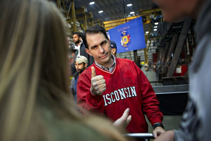 Wisconsin Gov. Scott Walker is out, but not before he put in place a vote suppression regime that may have thrown the state t
