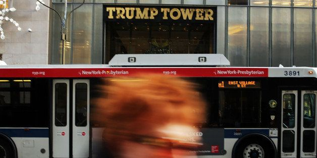 NEW YORK, NY - DECEMBER 08: People walk by the Trump Tower in Midtown Manhattan on December 8, 2015 in New York City. Donald