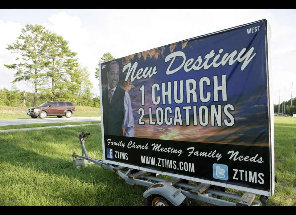 A sign with a photo of Pastor Zachery Tims is seen near the street at the New Destiny Christian Center in Apopka, Fla., Monda