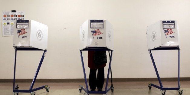 A voter is seen at a polling station during the New York primary elections in the Manhattan borough of New York City, U.S., A